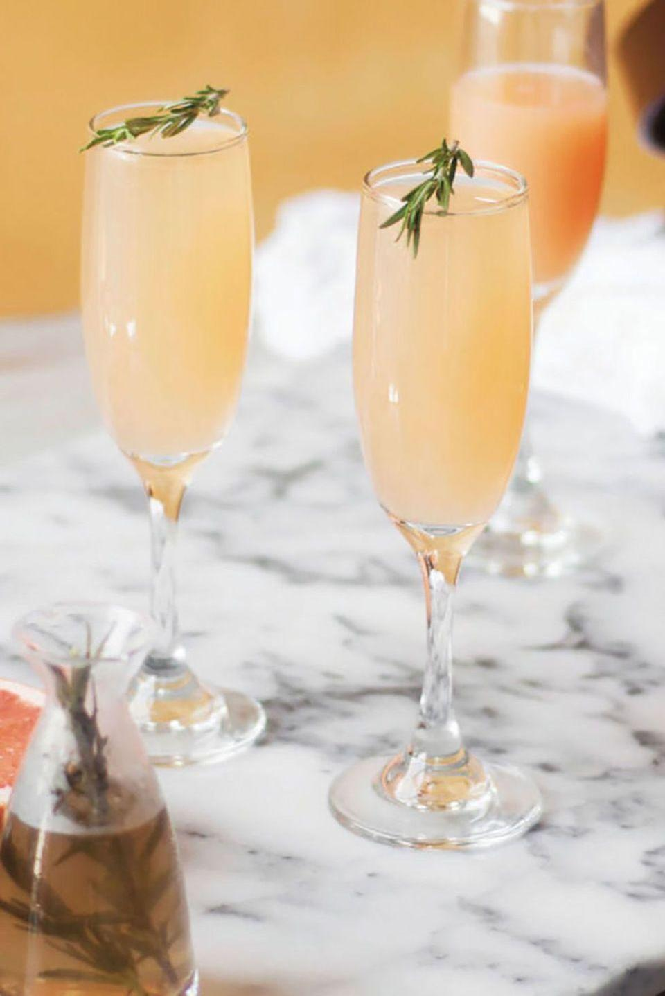 """<p>Cheers! Start her morning off with a celebratory sip of a refreshing mimosa—or should we say <em>mom-</em>osa? Don't forget the garnish!</p><p><strong><a href=""""https://www.countryliving.com/food-drinks/recipes/a42606/grapefruit-and-rosemary-mimosa/"""" rel=""""nofollow noopener"""" target=""""_blank"""" data-ylk=""""slk:Get the recipe"""" class=""""link rapid-noclick-resp"""">Get the recipe</a>.</strong></p><p><a class=""""link rapid-noclick-resp"""" href=""""https://www.amazon.com/Lenox-Tuscany-Classics-Fluted-Champagne/dp/B00006J00X?tag=syn-yahoo-20&ascsubtag=%5Bartid%7C10050.g.1681%5Bsrc%7Cyahoo-us"""" rel=""""nofollow noopener"""" target=""""_blank"""" data-ylk=""""slk:SHOP CHAMPAGNE FLUTES"""">SHOP CHAMPAGNE FLUTES</a> </p>"""