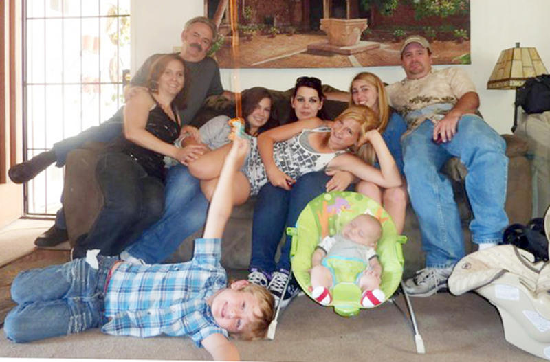 "FILE - In this June 2011 file photo provided by Andrea Saincome, Hannah Anderson, center, reclining across the laps of others, and James Lee DiMaggio, right, pose for a picture with other members of the extended Anderson and Saincome families. Via a social media site, Hannah Anderson says longtime family friend DiMaggio ""tricked"" her into visiting his house, tying up her mother and younger brother in his garage before escaping with her to the Idaho wilderness. Anderson says she cried all night after being rescued and learning that her family members were found dead at DiMaggio's burning house. Seated from left are: Christina Anderson; Christopher Saincome; Christina's sisters Samantha Saincome and Andrea Saincome; their niece Hannah Anderson, reclining; Alexi (last name unavailable, friend of Hannah's), and DiMaggio. On the floor are Ethan Anderson, left, and Andrea's infant child, whose name was not provided. (AP Photo/Courtesy of Andrea Saincome, File)"