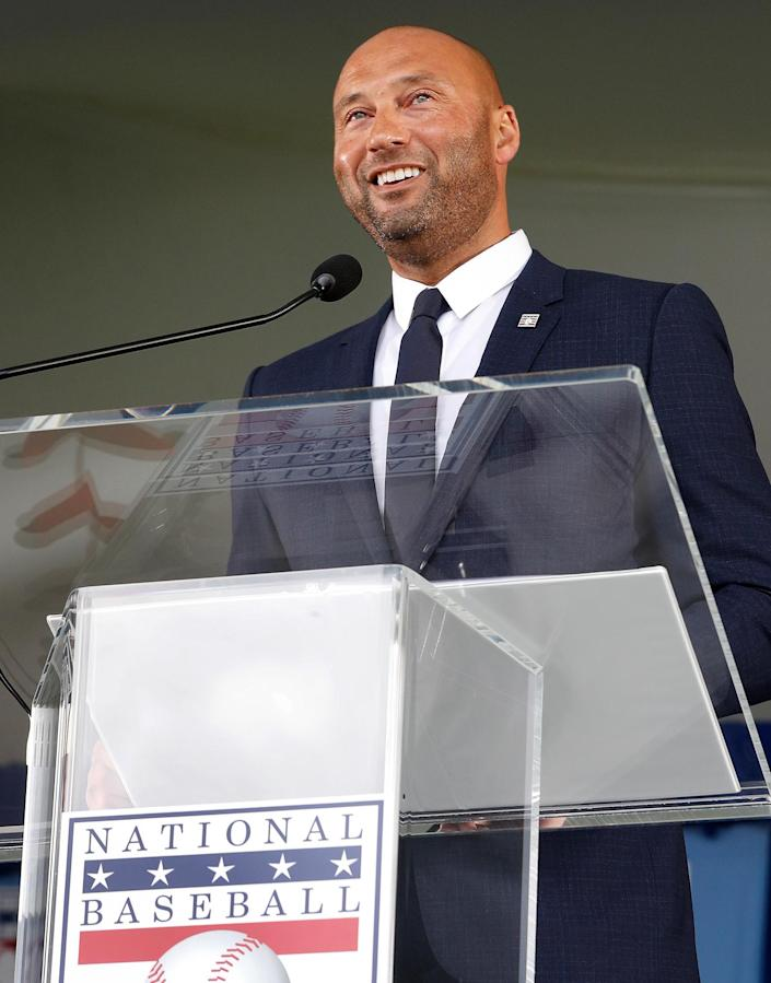 <p>Derek Jeter gives a speech during the Baseball Hall of Fame induction ceremony at Clark Sports Center on Sept. 8 in Cooperstown, New York.</p>
