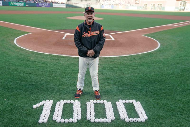 Jun 7, 2019; San Francisco, CA, USA; San Francisco Giants manager Bruce Bochy (15) stands in front of baseballs commemorating his total number of wins before a game against the Los Angeles Dodgers at Oracle Park. Mandatory Credit: Stan Szeto-USA TODAY Sports