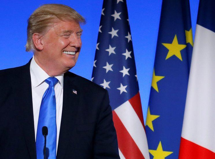 President Trumps reacts with French President Emmanuel Macron at the Elysee Palace in Paris, France.
