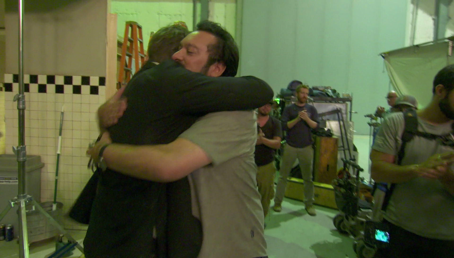 Hugh Jackman and James Mangold share a touching moment (20th Century Fox)