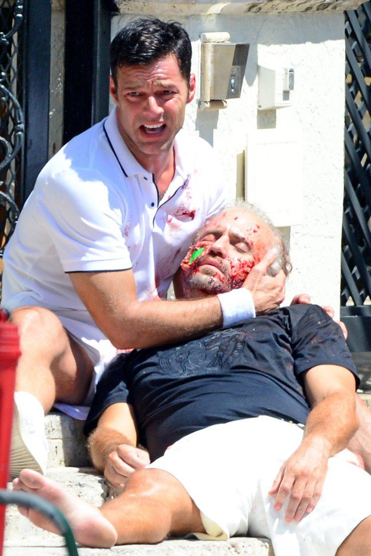 "Actors Ricky Martin and Edgar Ramirez film a bloody scene for the TV series ""Versace: American Crime Story"" in Miami. During the scene Ricky discovers that Gianni Versace (played by Ramirez) has been shot in front of his house. (Photo: Backgrid)"