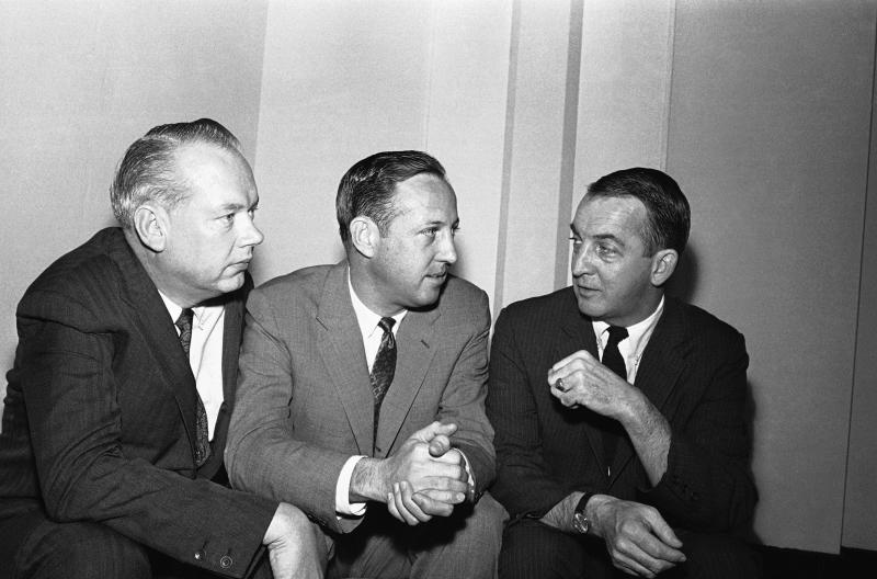 FILE - In this February 1966 file photo, NFL commissioner Pete Rozelle, center, discusses a new television contract for championship games with Bill MacPhail, left, vice president of CBS-TV, and John Reynolds, president of CBS-TV network, in Palm Beach, Fla. Pete Rozelle would not be surprised to see the NFLs impact of television as it celebrates its 100th season this year. It was Rozelle, the commissioner from 1960 to 1989, who was able to convince owners that it was in their best interest to sign a leaguewide rights deal instead of teams negotiating on their own. (AP Photo/File)
