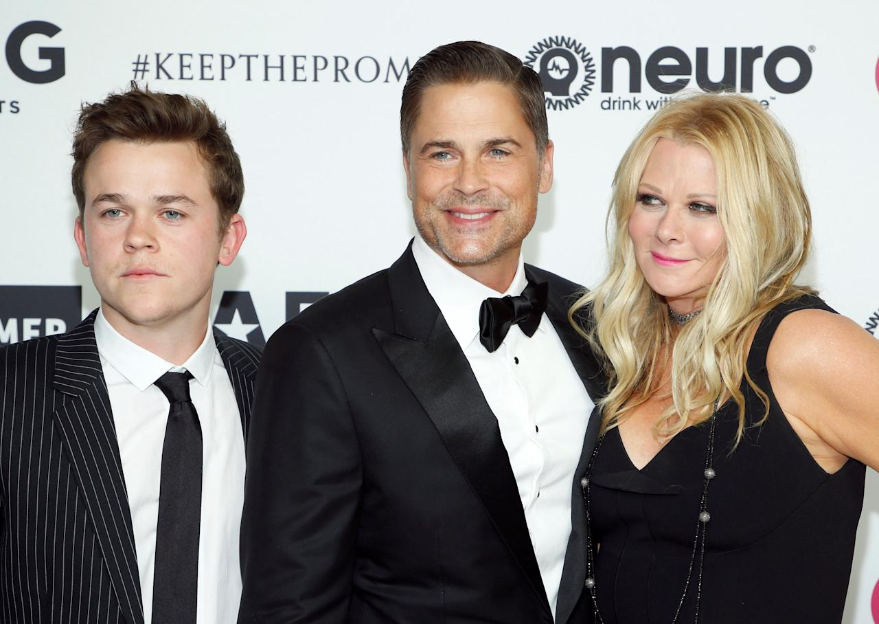 Actor Rob Lowe (C) wife Sheryl Berkoff (R) and their son John Owen Lowe (L) pose at Elton John's 70th Birthday and 50-Year Songwriting Partnership with Bernie Taupin benefiting the Elton John AIDS Foundation and the UCLA Hammer Museum at RED Studios Hollywood in Los Angeles, March 25, 2017. REUTERS/Danny Moloshok