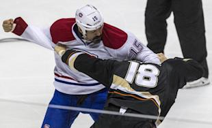 Montreal Canadiens right wing George Parros (15) fights with Anaheim Ducks right wing Tim Jackman (18) during the first period of an NHL hockey game, Wednesday, March 5, 2014, in Anaheim, Calif. (AP Photo/Ringo H.W. Chiu)