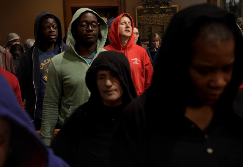 FILE - In this Sunday, March 25, 2012 file photo, Patrick Mulchay, center, joins other congregants in song during a service at Middle Collegiate Church in New York. Church-goers were invited to wear hoodies to services to show their support for justice in the case of Trayvon Martin, an unarmed black teenager who was wearing a hoodie on the night he was killed by a neighborhood watch volunteer in Sanford, Fla. (AP Photo/Seth Wenig)