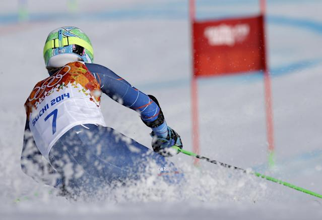 Gold medal winner, United States' Ted Ligety skis in the second run of the men's giant slalom to the Sochi 2014 Winter Olympics, Wednesday, Feb. 19, 2014, in Krasnaya Polyana, Russia. (AP Photo/Luca Bruno)