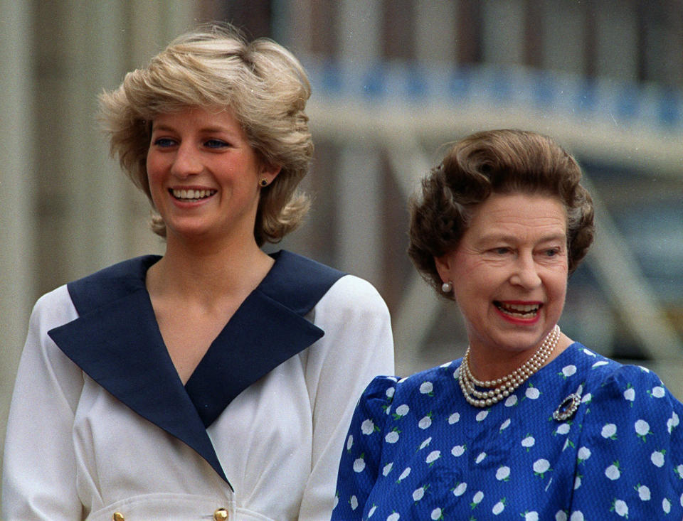 """FILE - In this Aug. 4, 1987 file photo, Britain's Diana, Princess of Wales, left, and Britain's Queen Elizabeth II smile to well-wishers outside Clarence House in London.For someone who began her life in the spotlight as """"Shy Di,"""" Princess Diana became an unlikely, revolutionary during her years in the House of Windsor. She helped modernize the monarchy by making it more personal, changing the way the royal family related to people. By interacting more intimately with the public -- kneeling to the level of children, sitting on edge of a patient's hospital bed, writing personal notes to her fans -- she set an example that has been followed by other royals as the monarchy worked to become more human and remain relevant in the 21st century. ( (AP Photo/Martin Cleaver, File)"""
