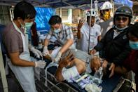 Security forces have fired live rounds at pro-democracy protesters in Myanmar and the wounded fear arrest if they are treated at government-run hospitals