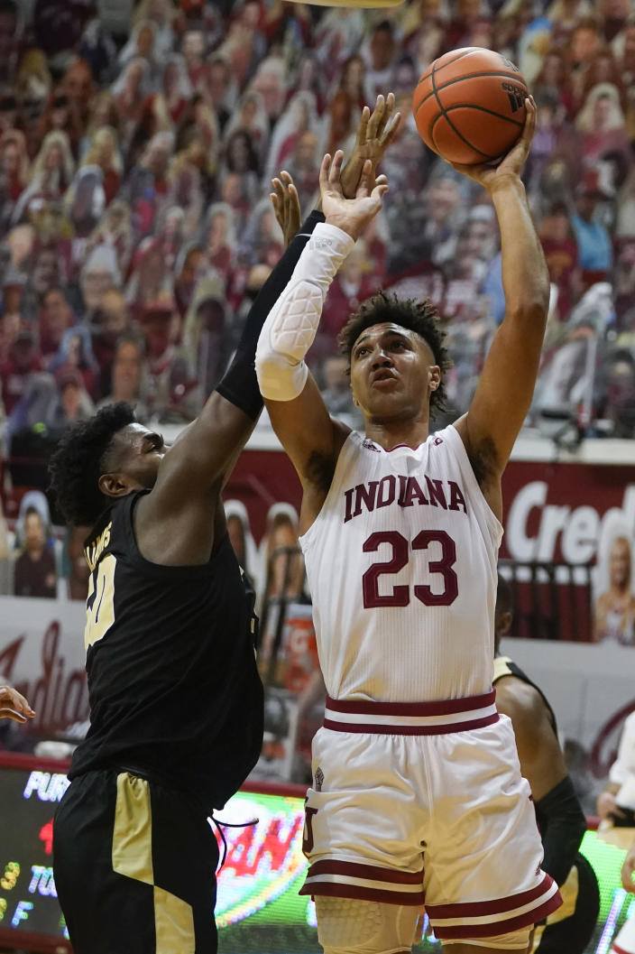 Indiana's Trayce Jackson-Davis (23) shoots over Purdue's Trevion Williams (50) during the second half of an NCAA college basketball game Thursday, Jan. 14, 2021, in Bloomington, Ind. Purdue won 81-69. (AP Photo/Darron Cummings)