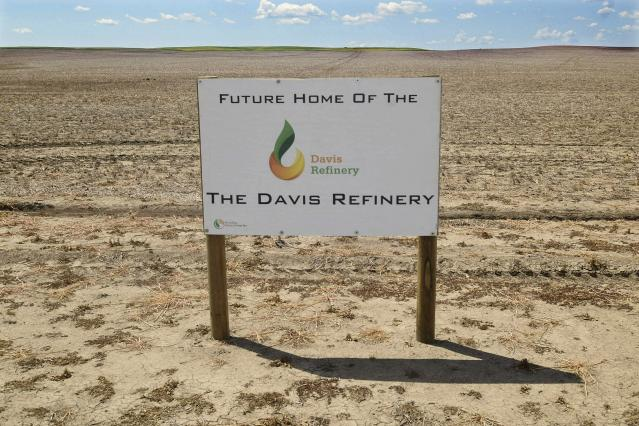 FILE--This July 19, 2018, file photo, shows the property in southwest Belfield, N.D that is the future home The Davis Refinery near Theodore Roosevelt National Park. Parties involved in a dispute over whether North Dakota regulators should be involved in the siting of a controversial oil refinery near Theodore Roosevelt National Park are battling in state court. The dispute is over whether state regulators should have reviewed the site of the $800 million Davis Refinery. Environmental groups say yes, but developer Meridian Energy and the state Public Service Commission are both urging a judge to rule against a hearing. (Tom Stromme/The Bismarck Tribune via AP)