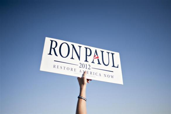 A supporter of Ron Paul holds a sign outside a Republican Presidential Debate in Ames, Iowa, August 11, 2011. (REUTERS/Daniel Acker)