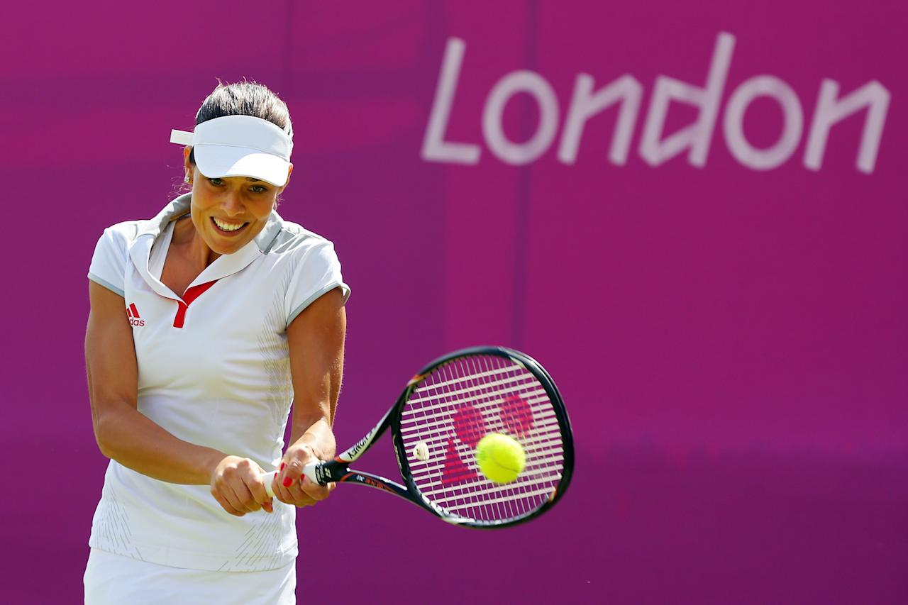 LONDON, ENGLAND - JULY 28:  Ana Ivanovic of Serbia returns a shot against Christina Mchale of the United States on Day 1 of the London 2012 Olympic Games at the All England Lawn Tennis and Croquet Club in Wimbledon on July 28, 2012 in London, England.  (Photo by Phil Walter/Getty Images)