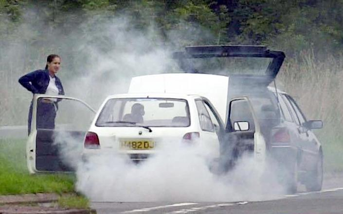 A car overheating on the exit slip road of the M5 motorway - Barry Batchelor/PA