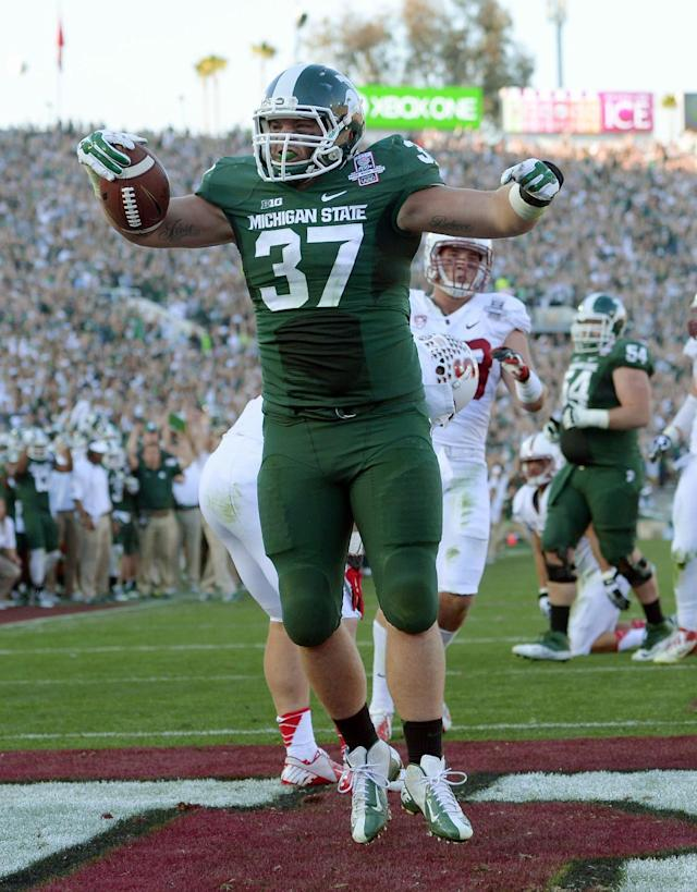 Michigan State fullback Trevon Pendleton celebrates a touchdown against Stanford during the first half of the Rose Bowl NCAA college football game on Wednesday, Jan. 1, 2014, in Pasadena, Calif. (AP Photo/Mark J. Terrill)