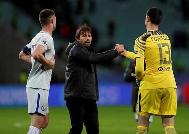 Chelsea manager Antonio Conte celebrates after the match with Thibaut Courtois and Gary Cahill Action Images via Reuters/Peter Cziborra