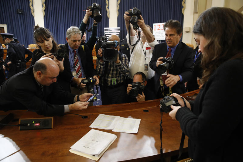 In this Dec. 13, 2019, photo, members of the press view the roll call vote recorded by the clerk after the House Judiciary Committee approved the articles of impeachment against President Donald Trump on Capitol Hill in Washington. Twenty-one years ago this Thursday, a Republican-led House voted to impeach then-President Bill Clinton. While that battle was bitterly partisan, it was blurrier than the clean, near party-line votes expected this week when the chamber _ now run by Democrats _ is poised to impeach Trump. (AP Photo/Patrick Semansky)