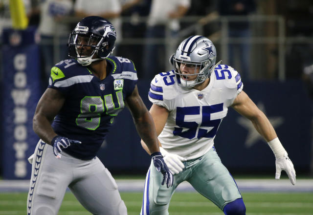 Seattle Seahawks tight end Ed Dickson (84) runs a route as Dallas Cowboys linebacker Leighton Vander Esch (55) defends during an NFC wild-card NFL football game in Arlington, Texas, Saturday, Jan. 5, 2019.(AP Photo/Roger Steinman)