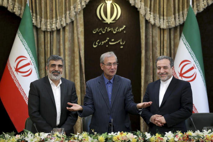 """From left to right, spokesman for Iran's atomic agency Behrouz Kamalvandi, Iran's government spokesman Ali Rabiei and Iranian Deputy Foreign Minister Abbas Araghchi, attend a press briefing in Tehran, Iran, Sunday, July 7, 2019. The deputy foreign minister says that his nation considers the 2015 nuclear deal with world powers to be a """"valid document"""" and seeks its continuation. (AP Photo/Ebrahim Noroozi)"""