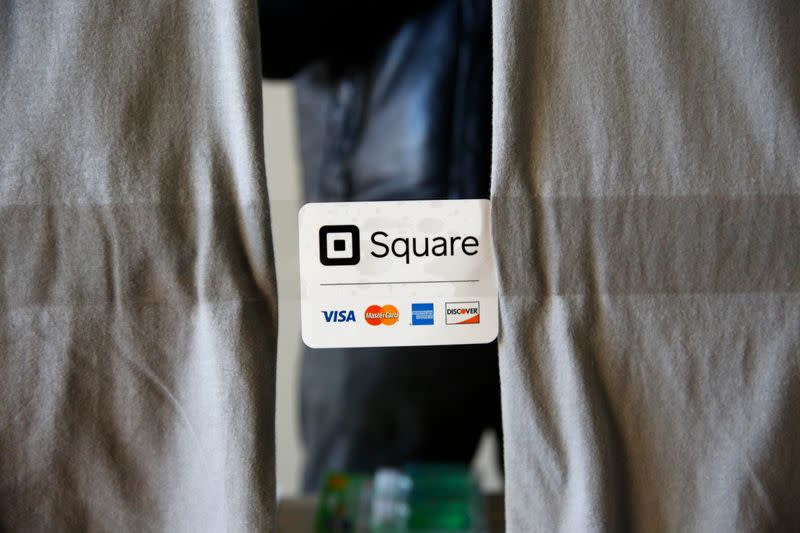 FILE PHOTO: An advertisement for the Square payment processor is seen outside a vendors site along the High Line in New York