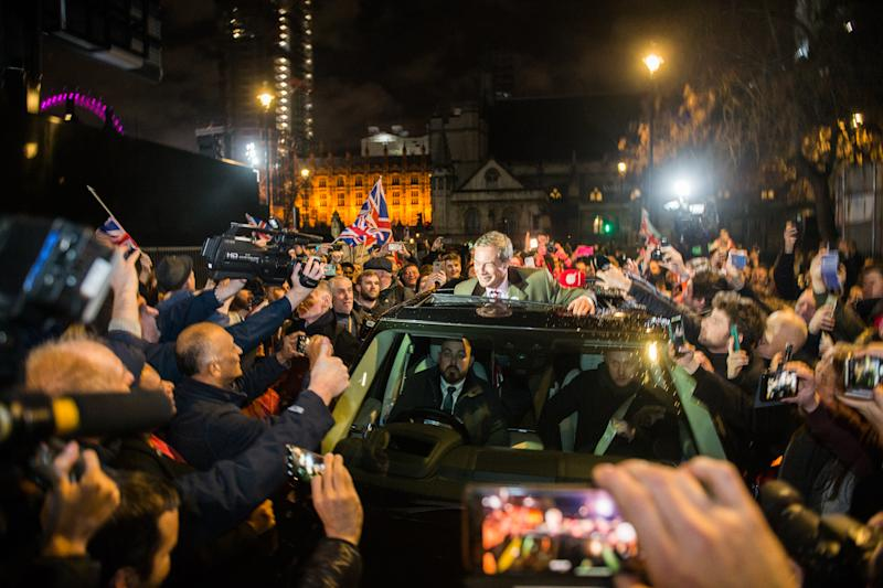 Farage gestures to fans through his car sunroof as he exits the Leave Means Leave Brexit Celebration in Parliament Square. (Getty)