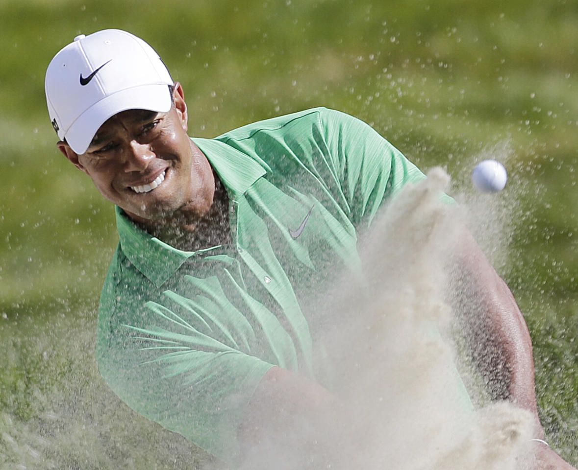 Tiger Woods hits out of the bunker on the seventh hole during the third round of the U.S. Open Championship golf tournament Saturday, June 16, 2012, at The Olympic Club in San Francisco. (AP Photo/Eric Gay)