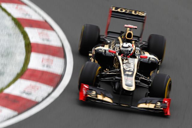 MONTREAL, CANADA - JUNE 08: Kimi Raikkonen of Finland and Lotus drives during practice for the Canadian Formula One Grand Prix at the Circuit Gilles Villeneuve on June 8, 2012 in Montreal, Canada. (Photo by Paul Gilham/Getty Images)
