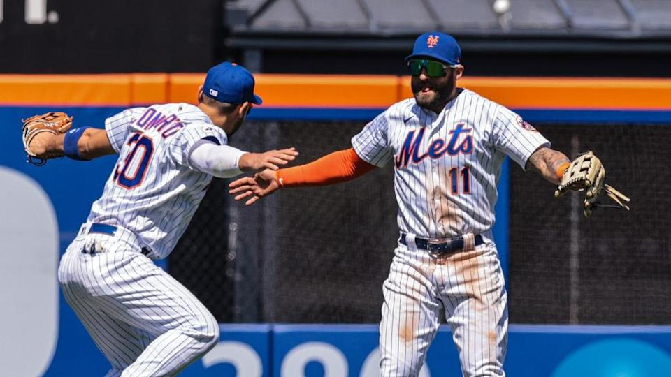 conforto pillar day game home whites high five after W