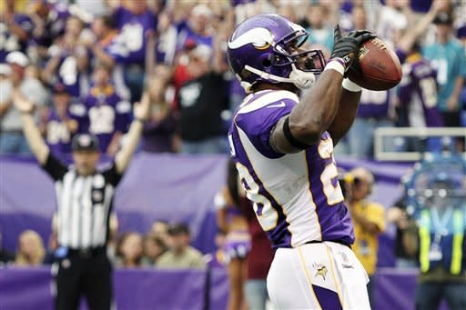 Minnesota Vikings running back Adrian Peterson reacts after scoring a touchdown during the first half of an NFL football game against the Jacksonville Jaguars, Sunday, Sept. 9, 2012, in Minneapolis. (AP Photo/Genevieve Ross)