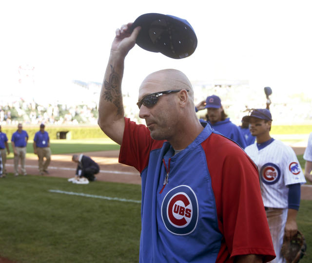 Chicago Cubs manager Dale Sveum salutes the fans as the Cubs celebrate a 4-2 win over the Pittsburgh Pirates after their last home baseball game Wednesday, Sept. 25, 2013, in Chicago. (AP Photo/Charles Rex Arbogast)