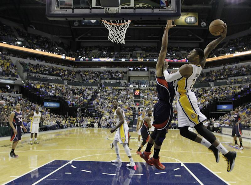 Indiana Pacers' Paul George (24) goes up for a dunk against Atlanta Hawks' Al Horford during the second half of Game 1 in the first round of the NBA basketball playoffs, Sunday, April 21, 2013, in Indianapolis. Indiana won 107-90. (AP Photo/Darron Cummings)