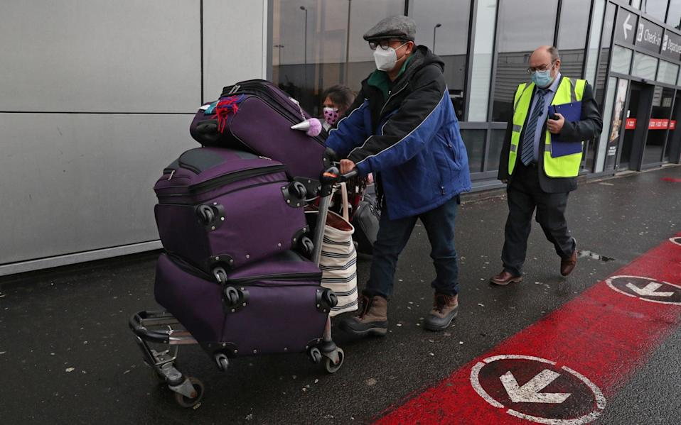 Chun Wong and his daughter Kiernan were among the first arrivals at Edinburgh Airport who needed to quarantine in a hotel - Andrew Milligan/PA