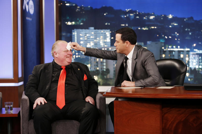 """This March 3, 2014 image released by ABC shows Toronto Mayor Rob Ford, left, having his forehead wiped by host Jimmy Kimmel on the late night talk show """"Jimmy Kimmel Live,"""" in Los Angeles. Ford laughed off Jimmy Kimmel's suggestion that he get help for his drinking problem and was reported to be upset about his appearance on the late-night TV talk show. Ford's appearance Monday night on """"Jimmy Kimmel Live"""" in Los Angeles was the culmination of months of wooing by the talk-show host to get Ford to appear as a guest. (AP Photo/ABC, Randy Holmes)"""