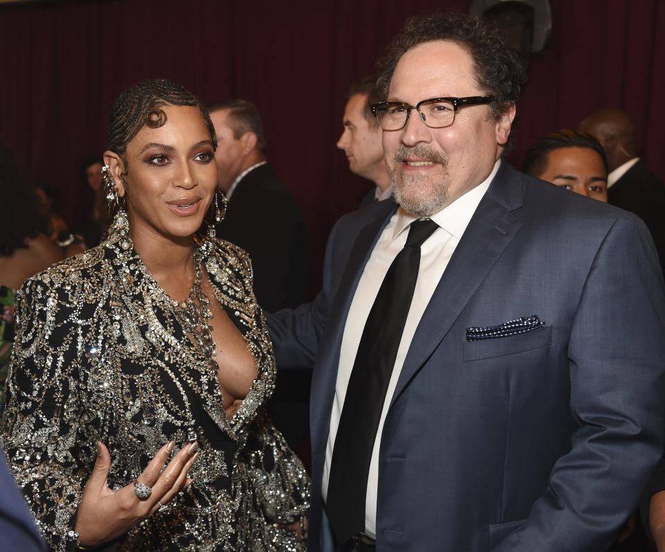 "Beyonce, left, a cast member in ""The Lion King,"" and the film's director Jon Favreau pose together at the premiere of the film, Tuesday, July 9, 2019, in Los Angeles. (Photo by Chris Pizzello/Invision/AP)"