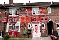 A house in Liverpool decorated in Liverpool FC's colours. The Liverpool team will lift the Premier League trophy tonight following their match against Chelsea. (PHOTO: Peter Byrne/PA Images via Getty Images)