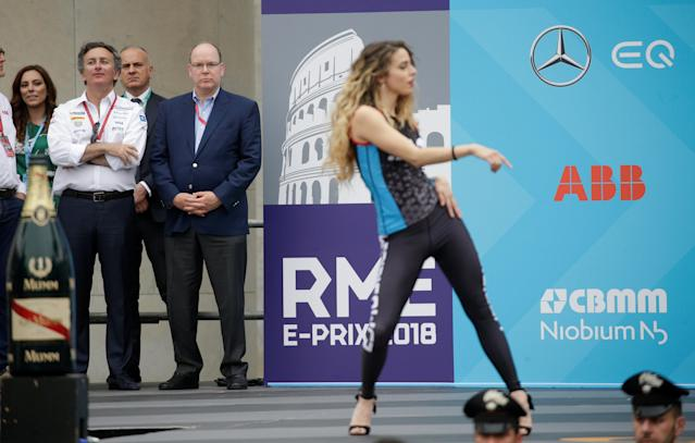Motor Racing - Formula E - Rome ePrix - Rome, Italy - April 14, 2018 Alejandro Agag, CEO of Formula E Holding, and Prince Albert II of Monaco look on as dancers perform on stage prior to the podium ceremony REUTERS/Max Rossi