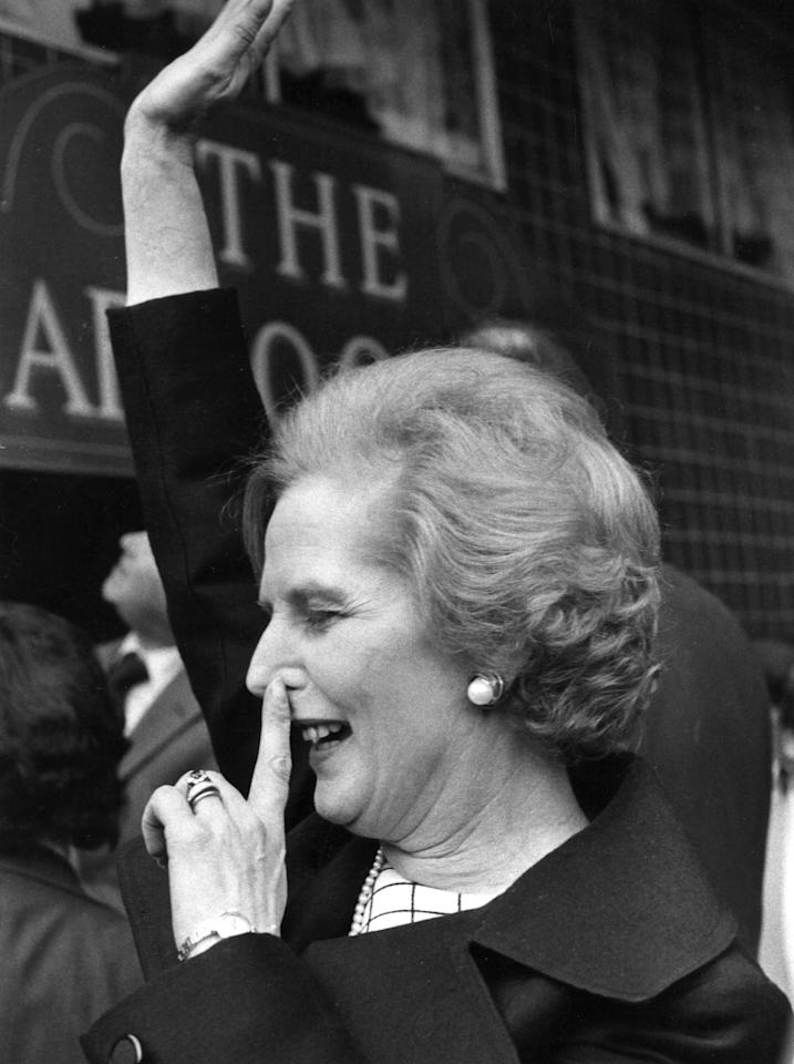 Conservative politician Margaret Thatcher with a finger on her nose and arm in the air, at the Cartoonist pub in London to receive the Gold Joker Award.   (Photo by Angela Deane-Drummond/Getty Images)