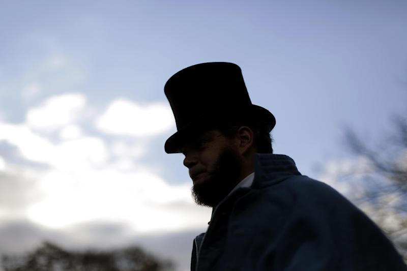 Bryce Stenzel of Mankato Minn., dressed as Abraham Lincoln, arrives before a ceremony commemorating the 150th anniversary of the dedication of the Soldiers' National Cemetery and President Abraham Lincoln's Gettysburg Address, Tuesday Nov. 19, 2013, in Gettysburg, Pa. Lincoln's speech was first delivered here nearly five months after the pivotal battle which was the Civil War's bloodiest conflict, with more than 51,000 casualties. (AP Photo/Matt Rourke)