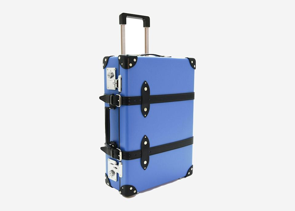"""<p>While this cheery, nautical suitcase gives off charming old world steamer trunk vibes, it's equipped with practical touches to get you through the demands of a 21st-century trip. It's as lightweight as it is sturdy, comes with thick leather accents, and features a wheeled base and retractable top handle to make for smoother cruising through airport terminals and train stations. Consider this a true investment piece.</p> <p><strong>Buy now:</strong> <a href=""""https://www.globe-trotter.com/shop/luggage/cruise-20-trolley-case/"""" rel=""""nofollow noopener"""" target=""""_blank"""" data-ylk=""""slk:$1,652, globe-trotter.com"""" class=""""link rapid-noclick-resp"""">$1,652, globe-trotter.com</a></p>"""