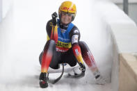 Natalie Geisenberger of Germany celebrates after her 2nd run during a women's race at the Luge World Cup event in Innsbruck, Austria, Sunday, Jan. 24, 2021. (AP Photo/Andreas Schaad)