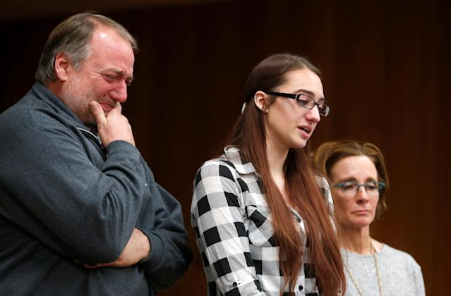 Megan Halicek gives her victim impact statement as her dad and coach stand with her during the sentencing hearing of Larry Nassar, a former team USA Gymnastics doctor who pleaded guilty in November 2017 to sexual assault charges, in the Eaton County Court in Charlotte, Michigan, U.S., February 2, 2018. REUTERS/Rebecca Cook