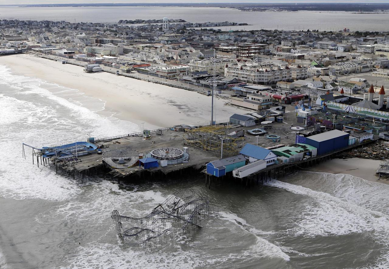 This aerial photo shows the damage to an amusement park left in the wake of superstorm Sandy on Wednesday, Oct. 31, 2012, in Seaside Heights, N.J. New Jersey got the brunt of Sandy, which made landfall in the state and killed six people. More than 2 million customers were without power as of Wednesday afternoon, down from a peak of 2.7 million. (AP Photo/Mike Groll)
