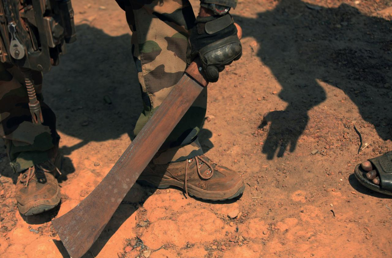A French soldier takes a machete away from resident in Bossangoa