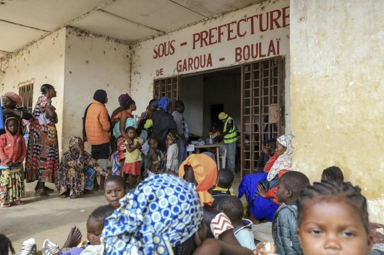 Refugees from the Central African Republic wait in line to register after crossing into Cameroon
