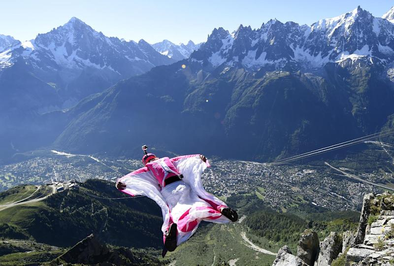 Switzerland's Geraldine Fasnacht jumps from the top of the Brevent mountain, in wingsuit, over the French ski resort of Chamonix, on July 16, 2014