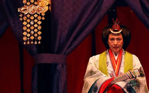 Empress Masako wore multi-layered coloured robes during the main ceremony - Credit: AFP