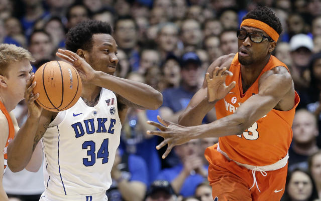 Duke's Wendell Carter Jr. (34) passes while Syracuse's Paschal Chukwu defends during the first half of an NCAA college basketball game in Durham, N.C., Saturday, Feb. 24, 2018. (AP Photo/Gerry Broome)