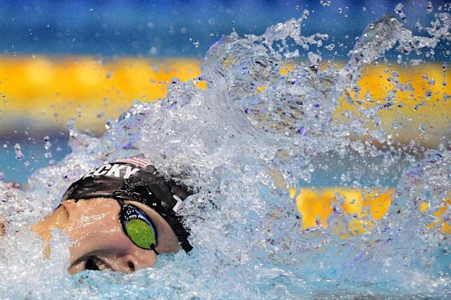 US swimmer Katie Ledecky bagged her third gold of the competition by pulverising the field in the women's 1,500m freestyle (AFP Photo/Martin BUREAU)