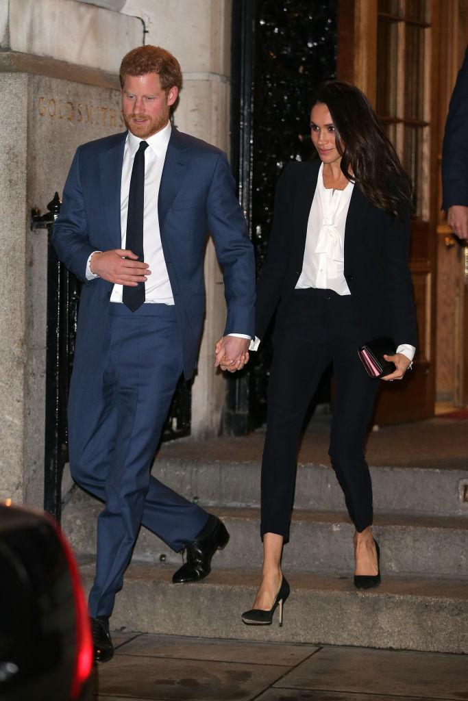 """<p>For her first evening <a href=""""https://uk.style.yahoo.com/meghan-markle-ditches-evening-gown-favour-two-piece-suit-awards-ceremony-195553369.html"""" data-ylk=""""slk:event;outcm:mb_qualified_link;_E:mb_qualified_link;ct:story;"""" class=""""link rapid-noclick-resp yahoo-link"""">event</a>, Meghan surprised the nation in a tux-style suit by Alexander McQueen. The former actress accessorised the look with a pussybow <a href=""""https://www.net-a-porter.com/gb/en/product/1011240/tuxe_bodywear/the-boss-pussy-bow-silk-crepe-de-chine-bodysuit?cm_mmc=LinkshareUS-_-J84DHJLQkR4-_-Custom-_-LinkBuilder&siteID=J84DHJLQkR4-u_KzPVHZ439pbkq2E675qA&ShopStyle+%28POPSUGAR%29=ShopStyle+%28POPSUGAR%29"""" rel=""""nofollow noopener"""" target=""""_blank"""" data-ylk=""""slk:blouse"""" class=""""link rapid-noclick-resp"""">blouse</a> by Tuxe Bodywear (£285). The awards look cost a cool £2,105 in total. <em>[Photo: Getty]</em> </p>"""